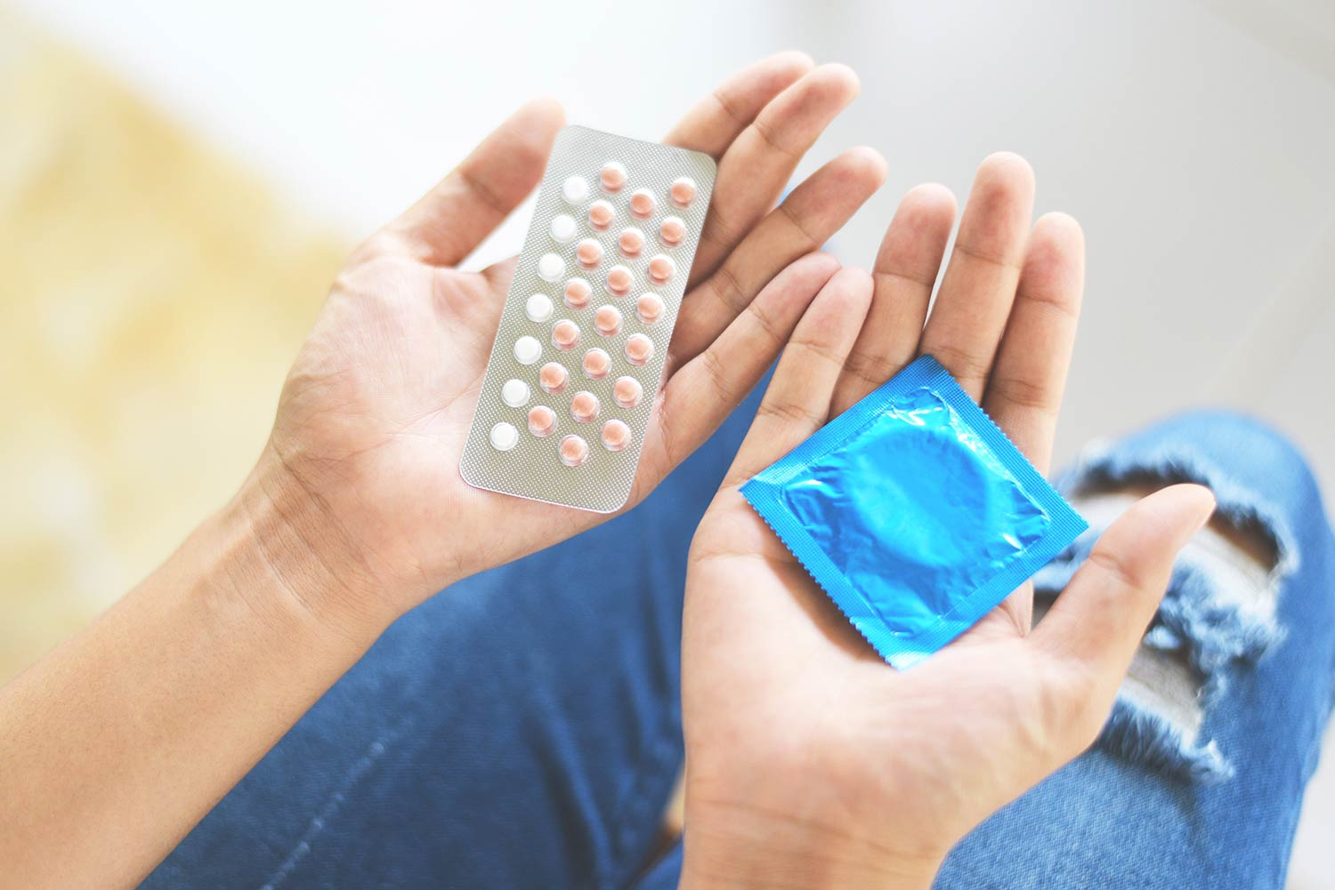 Woman holding contraceptive options